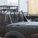 Защитная решетка на пикап NP300 с установкой на крышку Triffid Trucks